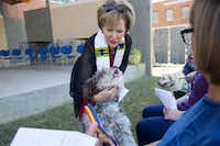 Rev. Wendy Fenn blessed jack, a mini Labradoodle, during a blessing of the animals at Encore Park.(Ting Shen/Staff Photographer)