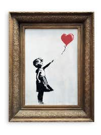 In this undated photo provided by Sotheby's, the spray-painted canvas <i>Girl With Balloon</i>by artist Banksy is pictured.(Sotheby's)