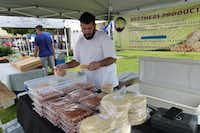 Mahammad Ammar is part of the Brothers Products family that specializes in Middle Eastern foods, including their best-selling cilantro hummus. Their dolmas are vegan.  At Coppell Farmers Market. (Kim Pierce/Special Contributor)