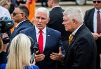 Vice President Mike Pence and U.S. Representative Pete Sessions answer questions from reporters upon arriving in Dallas on Monday, October 8, at Love Field Airport in Dallas. Pence will attend a Pete Sessions for Congress event and a Ted Cruz for Senate event before flying to Missouri later today. (Ashley Landis/Staff Photographer)