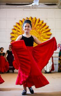 Eva Johnson, 7, dances during company auditions at the Anita N. Martinez Ballet Folklorico.(Ashley Landis/Staff Photographer)