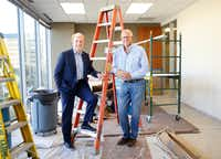 Former Dallas Cowboys players and now real estate partners Roger Staubach (left) and Robert Shaw are pictured in Roger's new office under construction at Columbus Realty Partners in Dallas.(Tom Fox/Staff Photographer)