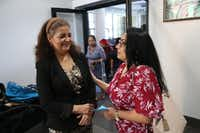 Dallas Area Interfaith organizer Socorro Perales (left) and churchgoer Maria De Jesus Fuerte discussed an upcoming political event after mass at Nuestra Se ora Del Pilar Catholic Church in Dallas on Sunday.(Obed Manuel/Staff )