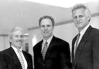 From left: Jim Leslie, Roger Staubach and Robert Shaw are shown in 2000 after announcing the formation of a development company, Amicus Partners.(Courtesy photo)