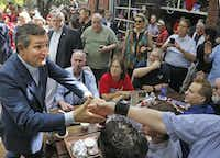 Sen.Ted Cruz works the crowd as he campaigns at the Katy Trail Ice House Outpost in Plano on Thursday, Oct. 4, 2018.(Louis DeLuca/Staff Photographer)