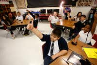 Adrian Torres gives the thumbs up to a correct answer during his fifth grade math class at Annie Webb Blanton Elementary in Dallas on May 17, 2018. Blanton Elementary is one of Dallas ISD's ACE schools where extra money and resources have been poured in to bolster struggling campuses.(Nathan Hunsinger/Staff Photographer)