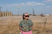 Suzanne Franklin stands near her home in Reeves County, West Texas, on April 11, 2018. Some mornings Franklin wakes with a nose full of dried blood, her voice filled with gravel. Her husband Jim suffers from respiratory problems, too. Complaints like hers are common among people who live near gas sites, academic research has found. Flares burning off gas spew pollutants that assault the respiratory system. (Marjorie Kamys Cotera/AP)
