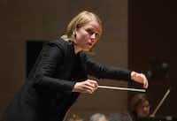 Ruth Reinhardt conducts the Dallas Symphony Orchestra in Paul Hindemith's <i>Concert Music for Strings and Brass</i>.(Rex C. Curry/Special Contributor)