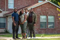 Sammie Anderson, second from left, poses with her sons (from left to right) Samuel Bible, 18, Tyrone Anderson, 15, and Grant Bible at their home in DeSoto, Monday, September 17, 2018.(Brandon Wade/Special Contributor)