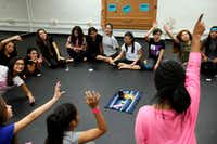 Dance teacher Alexis Brisby, far-right, asks her students to raise their hand during a vote to improve their class time during a Restorative Class session, also known to students as circling, on Friday, Sept. 23, 2016 at Gaston Middle School in Dallas. The dialogue circles are used for students to talk about their feelings and issues in and out of class. What's said in the circle, stays in the circle.(Ben Torres/Special Contributor)