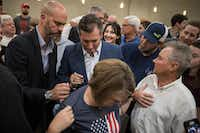 Sen. Ted Cruz signed a supporter's shirt after a rally last week in Conroe.(Loren Elliott/Getty Images)