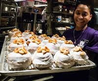 New Orleans' District Donuts occupies a prime space at the Cosmopolitan's Block 16 food hall. District offers more than 100 doughnut varieties.(Michael Hiller/Special Contributor)