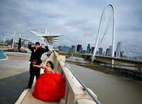 <p>Ari Hernandez of Denton poses for quinceañera photos with her date Neven Campos at the Margaret Hunt Hill Bridge.</p>(Tom Fox/Staff Photographer)