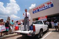 "U.S.  Senate candidate Victor Morales, shown campaigning from the back of his ""little  white truck"" in Mesquite in June 1996, came closer than any other Democrat to winning in the past nine Texas Senate races — and still lost by 11 percentage points.(File 1996/The Dallas Morning News)"