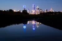 The downtown Dallas skyline lights up in blue in recognition of National Police Week on May 15, 2017. (Smiley N. Pool/Staff Photographer)