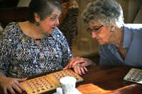 Bonnie Carlson, (left)  talks with her friend, Edith Crittenden during their weekly bingo game at Overture Ridgmar in Fort Worth on Weds., Oct. 10, 2018.(Daniel Carde/Staff Photographer)