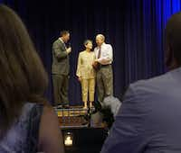 "<p><span style=""font-size: 1em; background-color: transparent;"">The Rev. Brent Ashby blesses Jim Spell and Pam Davidson at their wedding reception at Presbyterian Village North.</span></p>(Lawrence Jenkins/Special Contributor)"