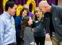 Sixth-grader Alanna Mazeffa, 11, talked to Frisco ISD Superintendent Mike Waldrip after she was celebrated as the 60,000th student to be enrolled in Frisco ISD at a celebration Tuesday at Pioneer Heritage Middle School in Frisco. Her father, Ryan Mazeffa, is at left. Alanna and her family recently moved from Pittsburgh, Pa.(Ashley Landis/Staff Photographer)