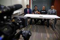 Allison Jean, the mother of Botham Jean, speaks next to her husband Bertrum Jean (second from right) and attorneys Lee Merritt (far left) and Daryl Washington (far right) during an interview in Dallas on Tuesday. Botham Jean was shot and killed in his apartment by Dallas police officer Amber Guyger. She was later charged with manslaughter. The Jeans live in St. Lucia.(Rose Baca/Staff Photographer)