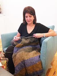 Diane Seimetz Duncan started knitting more than 30 years ago to give her something to do with her hands when she quit smoking. She's making this sweater for her husband.  (Diane Seimetz Duncan)