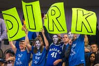Fans cheer for Dallas Mavericks center Dirk Nowitzki.(Smiley N. Pool/Staff Photographer)