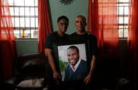 Allison and Bertrum Jean hold a photo of their son Botham Jean at their home in St. Lucia. Botham Jean was shot and killed in his apartment by off-duty Dallas police officer Amber Guyger.(Vernon Bryant/Staff Photographer)