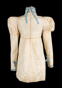 An  ivory  silk  moire minidress  worn  by  Sharon  Tate  at  her  London  wedding  to  Roman  Polanski  in  1968. The dress is being sold at an upcoming auction, where it figures to bring between $25,000 and $50,000. (Julien's Auctions)