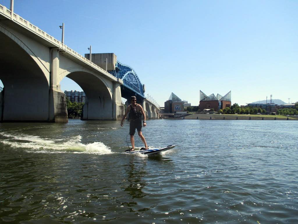 The Onean Carver electric surfboard, among cutting-edge gear available for rent from Adventure Sports Innovation in Chattanooga, lets you surf up to 25 mph, without waves, on the Tennessee River as it runs through downtown.(Robin Soslow/Special Contributor)