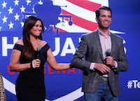 Donald Trump Jr., and Kimberly Guilfoyle appear at a rally for Republican U.S. Senate candidate John James in Pontiac, Mich., Wednesday, Oct. 17, 2018.(Paul Sancya/The Associated Press)