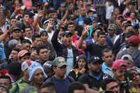 "<p><span style=""font-size: 1em; background-color: transparent;"">Members of an immigrant caravan sang the Honduran national anthem while gathering to discuss crossing the Guatemalan border into Mexico on Friday in Tecun Uman, Guatemala. The caravan of thousands of Central Americans, mostly from Honduras, hopes to eventually reach the United States. President Donald Trump has threatened to cancel the recent trade deal with Mexico and withhold aid to Central American countries if the caravan isn't stopped before reaching the U.S. </span><strong style=""font-size: 1em; background-color: transparent;"">​</strong></p>(John Moore/Getty Images)"