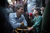 U.S. Rep. Beto O'Rourke  was interviewed by a young supporter following a Senate race campaign rally in the Dallas area  on Saturday.   O'Rourke is fighting to unseat Sen. Ted Cruz. (Loren Elliott/Agence France-Presse)