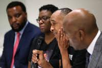 Bertrum Jean, the father of Botham Jean, speaks next to his wife, Allison Jean, and attorneys Lee Merritt (far left) and Daryl Washington (far right) during an interview in Dallas last week with The Dallas Morning News.(Rose Baca/Staff Photographer)