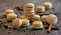 Basic macaron shells are filled with Chocolate Chai Spice Ganache and sprinkled with more chai spice.(Louis DeLuca/Staff Photographer)