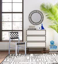 The black-and-white pieces in the the Now House collection feature clean lines and graphic accents. The three-drawer dresser by Jonathan Adler is $448.(Amazon)