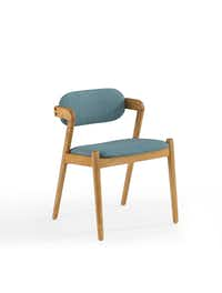 Jonathan Adler's Now House collection features a mid-century dining chair in light wood with blue linen upholstery. It's $198.(Amazon)