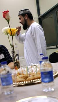 <p>Imam Zia Sheikh breaks a dawn-to-dusk fast during a Ramadan dinner at the Islamic Center of Irving in 2011.</p>(File Photo/Staff)