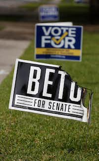 Beto O'Rourke and Colin Allred signs were burned Tuesday night in Richardson.(Nathan Hunsinger/Staff Photographer)