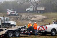 Texas Department of Transportation crews razed the imprint of an iconic Texas-shaped sign on a hillside median off Interstate 20 between Mountain Creek Parkway and Spur 408 in southwest Dallas on Dec. 13, 2016. The sign was removed because of safety concerns, since visitors drove off the road to get to the sign and had to merge back onto the interstate without an entrance ramp. (Tom Fox/Staff Photographer)