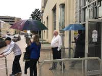 Glenn Halfin (center) leaves the federal courthouse in Fort Worth after being sentenced to a year in prison for hanging a black baby doll in front of his African American neighbors' apartment.(Kevin Krause/Staff)