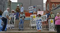 People protested in May 2016 across from the Morton H. Meyerson Symphony Center in Dallas, where Exxon Mobil's annual shareholder meeting was being held.(File Photo/Staff)