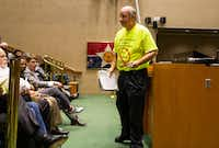 Dale Davenport, owner of Jim's Car Wash, walks away from the podium after addressing the members of the city council at Dallas City Hall on Wednesday, October 24, 2018. Members of the public gave their comment regarding a resolution requesting the Board of Adjustment to authorize compliance proceedings for Jim's Car Wash. (Shaban Athuman/The Dallas Morning News)(Shaban Athuman/Staff Photographer)