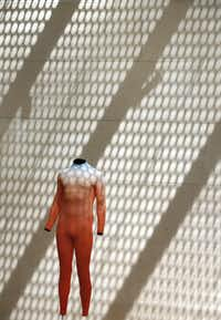 Shadows fall across the wall, affecting the presentation of the work of sculptor Alex Israel at the Nasher Sculpture Center in August, 2018.(Louis DeLuca/Staff Photographer)