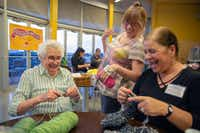 Sunny Shor (left), Nancy Bernstein (center) and Spreading the Warmth founder Christine Nicolette-Gonzalez share a laugh during the monthly Knit Night at Whole Foods in Preston Forest. (Allison Slomowitz/Special Contributor)