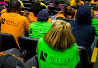Two buses full of people wearing Steele Properties shirts went to Dallas City Hall on Monday.(Carly Geraci/Staff Photographer)