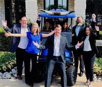 Valiant Residential's leadership team and onsidte staff gather around CEO Craig Lashley.(Valiant Residential)