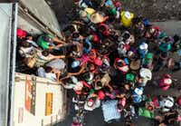Honduran migrants taking part in a caravan heading to the U.S. get on a truck near Pijijiapan in southern Mexico on October 26, 2018. (GUILLERMO ARIAS/Agence France-Presse)