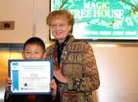 Mary Pope Osborne, author of the best-selling children's book series, The Magic Tree House, poses for a photograph with Kalem Xu, third grader from Borchardt Elementary School in Plano. Kalem was one of 12 winners of the 2017 Celebration of Reading Student Essay Contest sponsored by the Barbara Bush Foundation.. (David Woo/The Dallas Morning News)(David Woo/Staff Photographer)