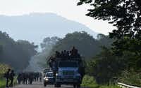 Thousands of Central American migrants continued their journey toward the U.S. border Thursday, Oct. 24, 2018, reaching the coastal town of Mapastepec, in Chiapas, Mexico. (Miguel Juarez Lugo/TNS)