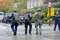 Polikce respond to an active shooter situation at the Tree of Life synagogue on Wildins Avenue in the Squirrel Hill neighborhood of Pittsburgh, Pa., on Saturday, October 27, 2018. (Pam Panchak/Pittsburgh Post-Gazette via AP)(Pam Panchak/AP)