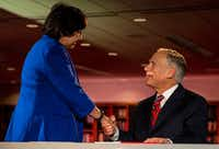 Texas Governor Greg Abbott shakes hands with Lupe Valdez, his Democratic challenger, before a gubernatorial debate at the LBJ Library in Austin, Texas, on Friday, Sept. 28, 2018.(Nick Wagner/AMERICAN-STATESMAN)